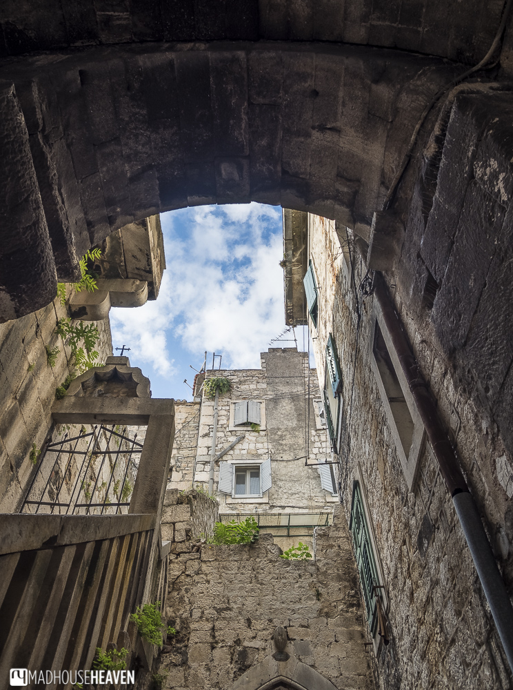 Split Living in Ancient Rome, patch of sky above buildings, quaint streets, old europe,