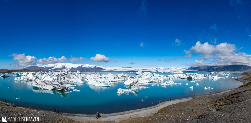 Panorama of the Jökulsárlón Glacier Lagoon in Iceland, with its blue ice icebergs
