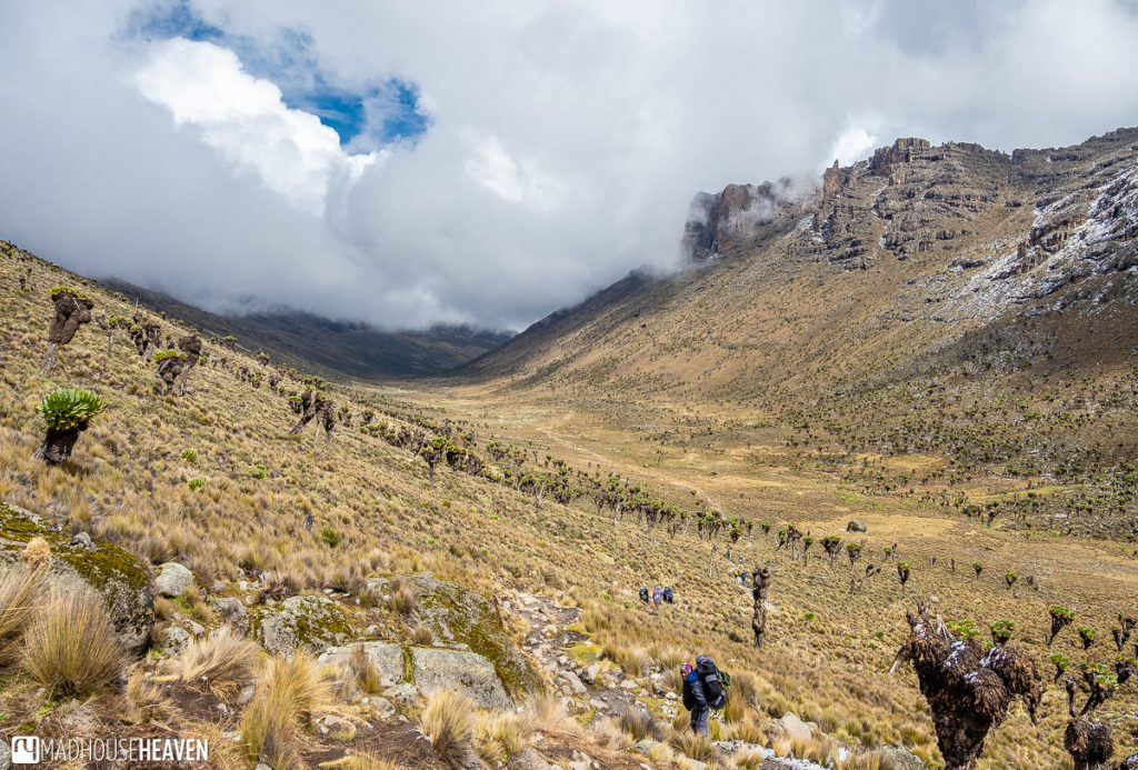 A wide valley high on Mount Kenya, covered in clouds