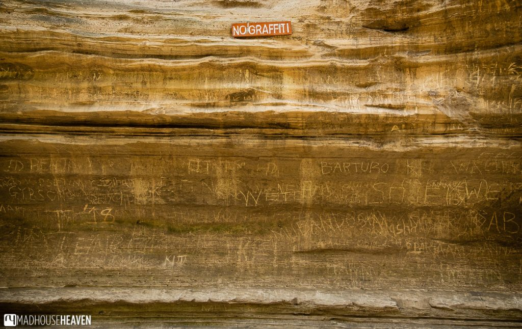 "Graffiti on one of the walls of the Ol Njorowa Gorge in the Hell's Gate National Park, right under the sign saying ""No Graffiti"""