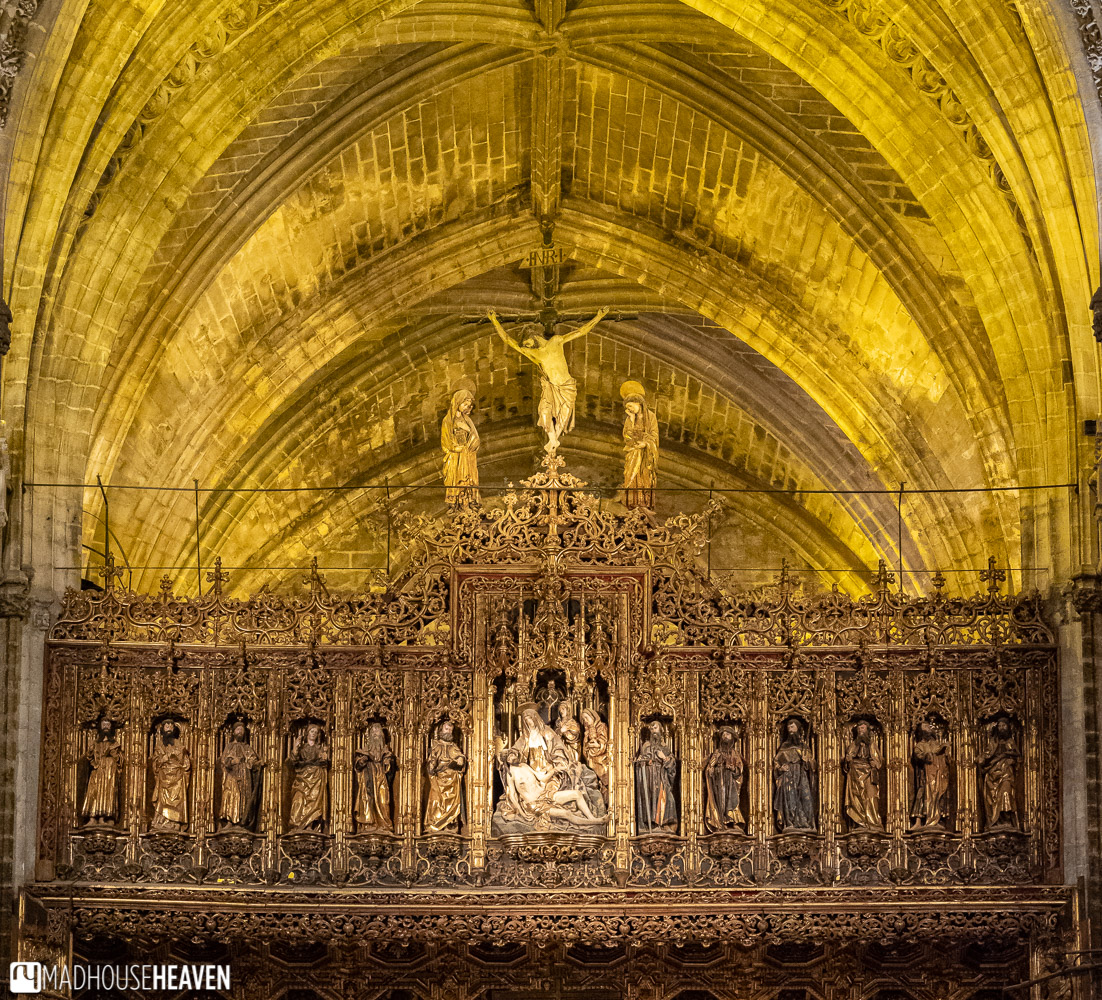 The view of the top part of the wooden altarpiece of the Seville Cathedral, full of incredible, intricate details
