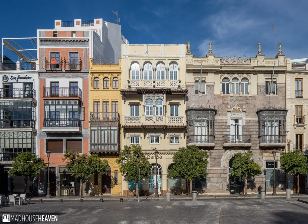 Residential buildings in Seville old town showcase traditional Andalusian architecture