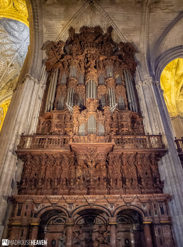 The grand organ of the Seville Cathedral touching the vaulted Gothic roofs