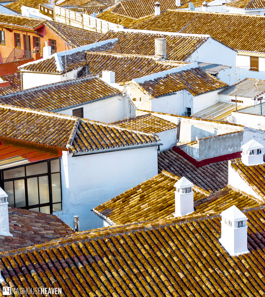 White walls of the Andalusian houses create a hypnotic pattern with their red and earthen coloured tiled roofs