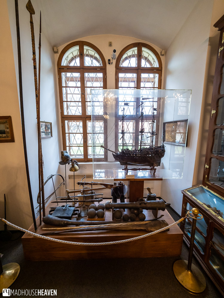 A display of nautical artefacts and instruments, including a narwhale horn