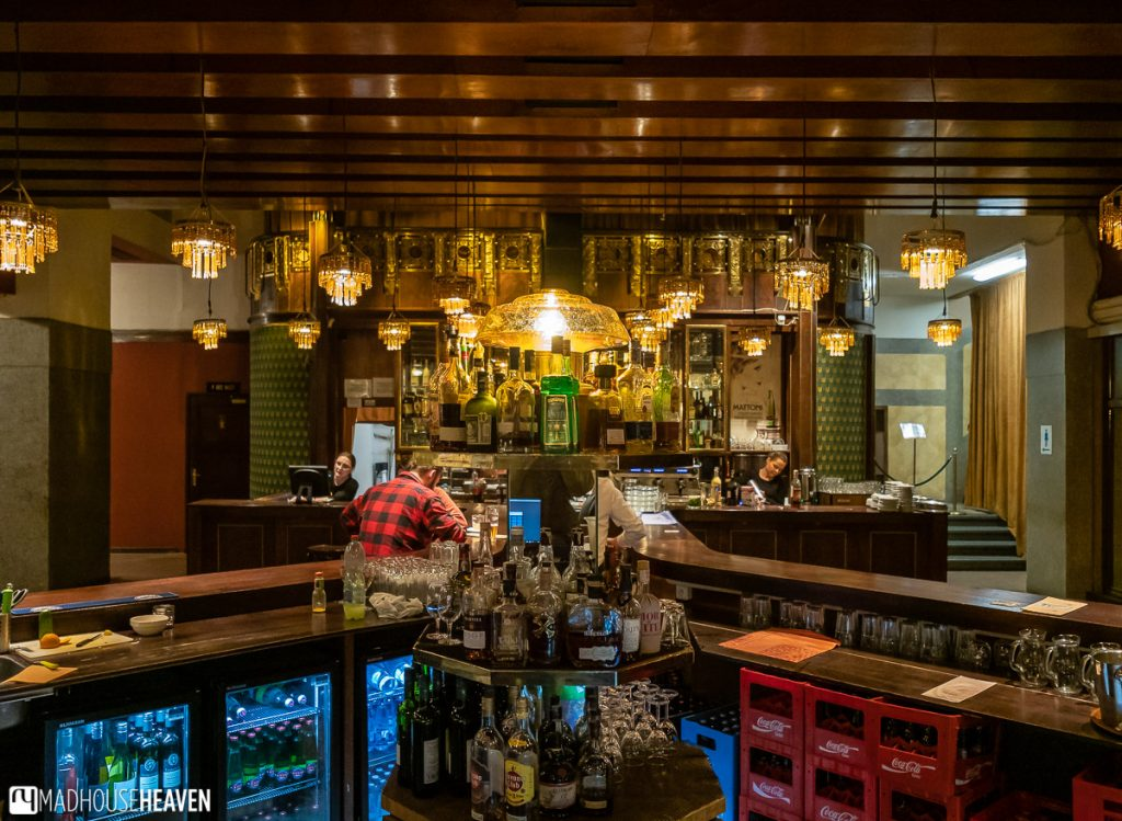 Striking heavy wood beams decorated with steampunk chandeliers