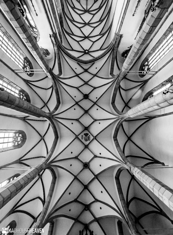 The Gothic ceiling of the St. Vitus Church with light coming through the windows