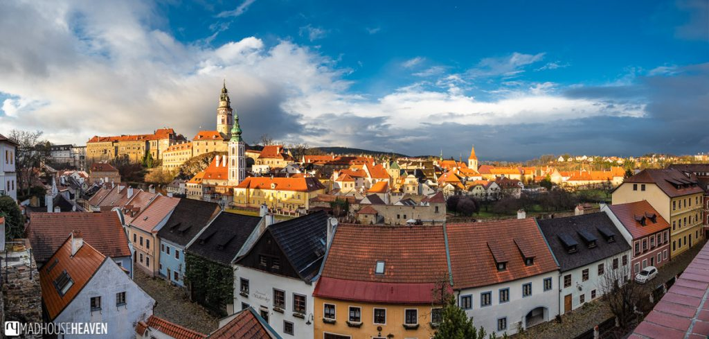 Wide angle view of Cesky Krumlov Old Town with the castle tower and medieval houses in the foreground