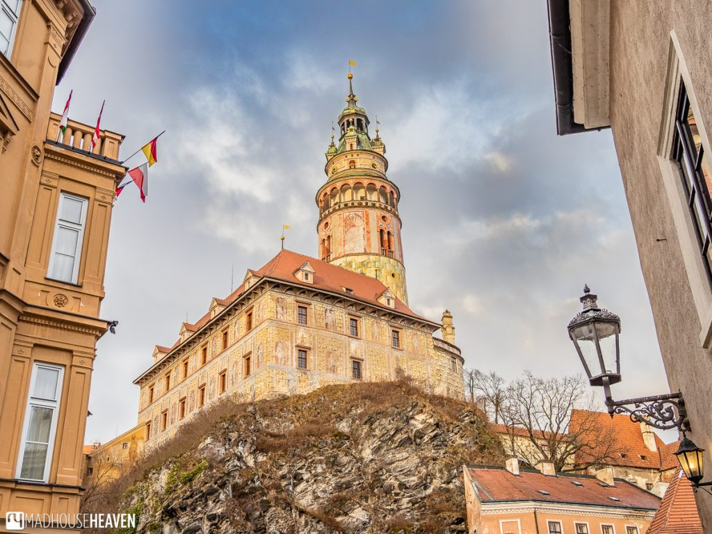The Český Krumlov tower and castle sitting on the solid graphite rock the land is made of