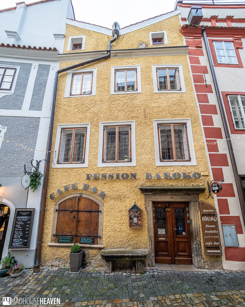 A charming hotel with yellow walls in a historic building in the medieval town of Cesky Krumlov