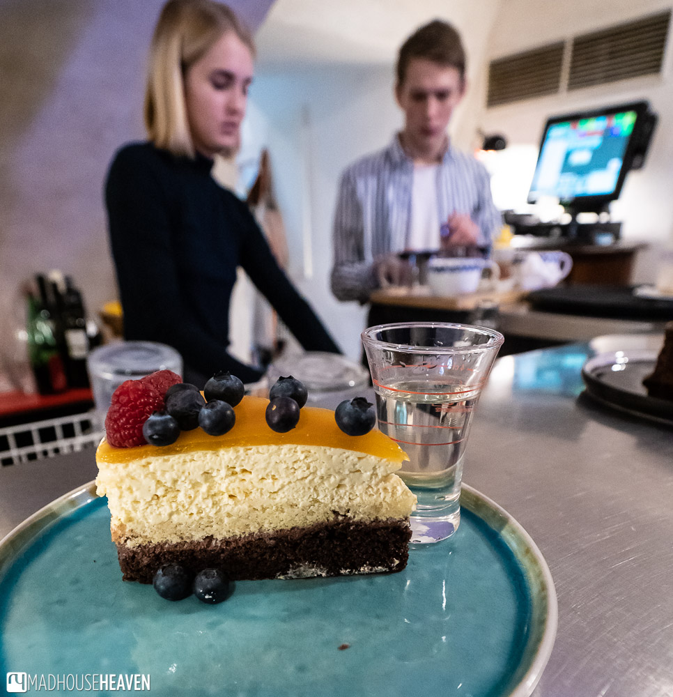 Mango mousse cake and Czech brandy in a cafe