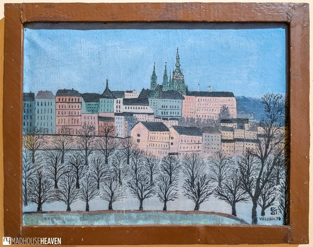 A simple and graphic painting of Český Krumlov, featuring the castle