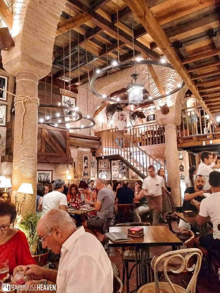 Interior of a large Spanish style country house with high columns and wooden rafters