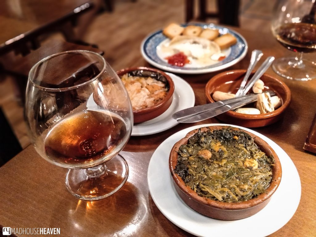 tapas of spinach and shrimps, local cheese with marmalade and homemade beans