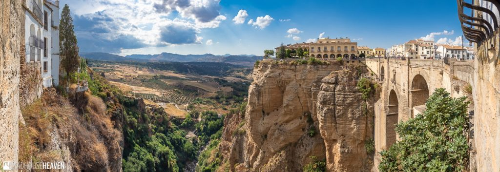 Panorama of the famous Puente Nuevo bridge in Ronda, with the Parador de Ronda visible on the other side