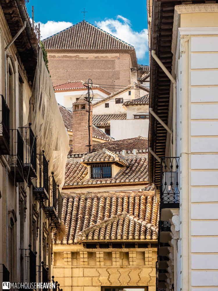 View of the roofs of the Albaicín district from one of the side streets along the El Darro river