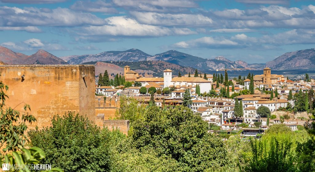 The houses of Granada as a backdrop for one of the towers of Alhambra