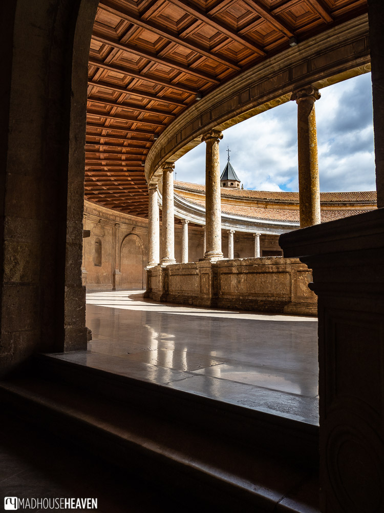 The upper level of the Palacio de Carlos V in Alhambra, its marble floor polished to perfection