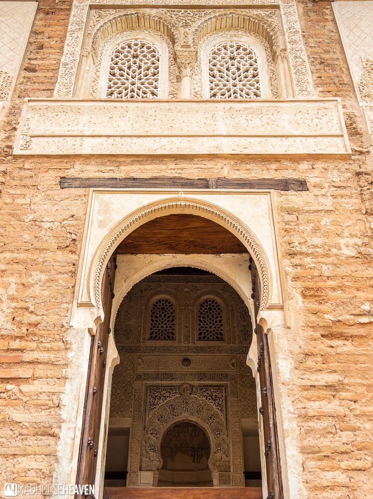 Elaborate Moorish designs  cover the windows and doorways of the Chapel of the Partal, Alhambra