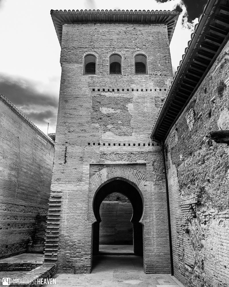Black and white image of a building in Alhambra, with interesting architectural details