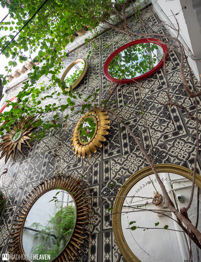 A Moorish courtyard with quirky mirrors and vines on its wall