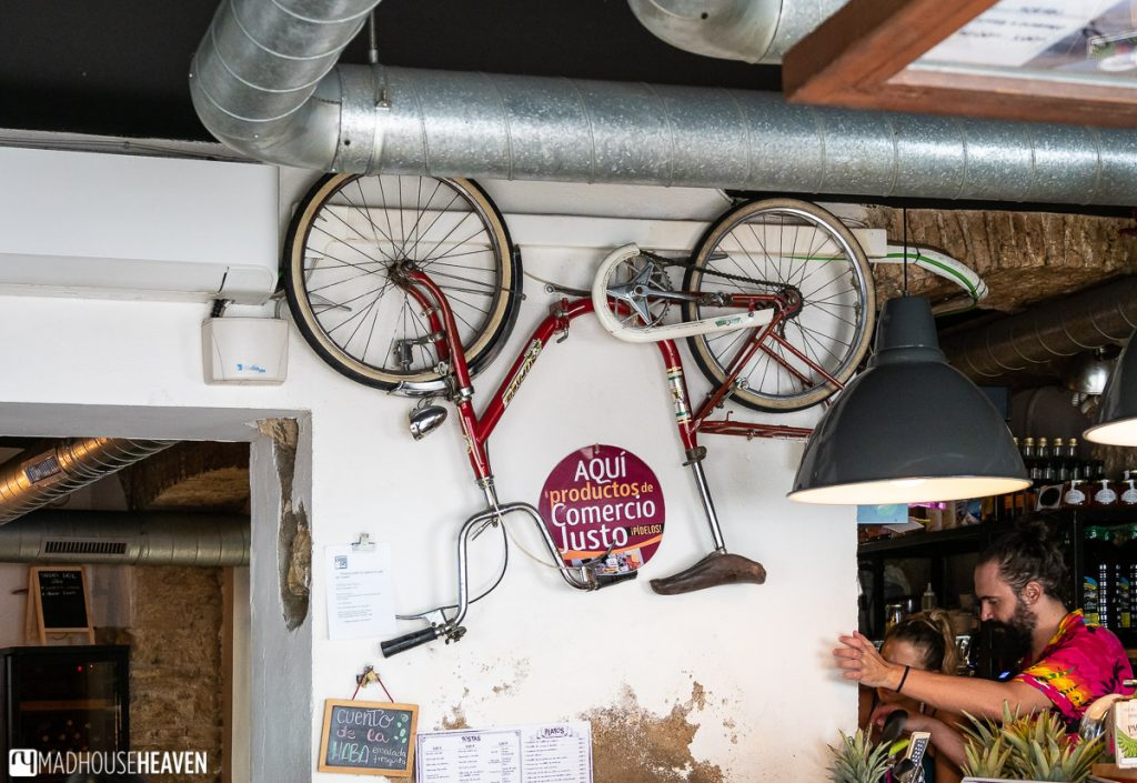 A bicycle hung upside down in the interior of the bar 'La Bicicleta'