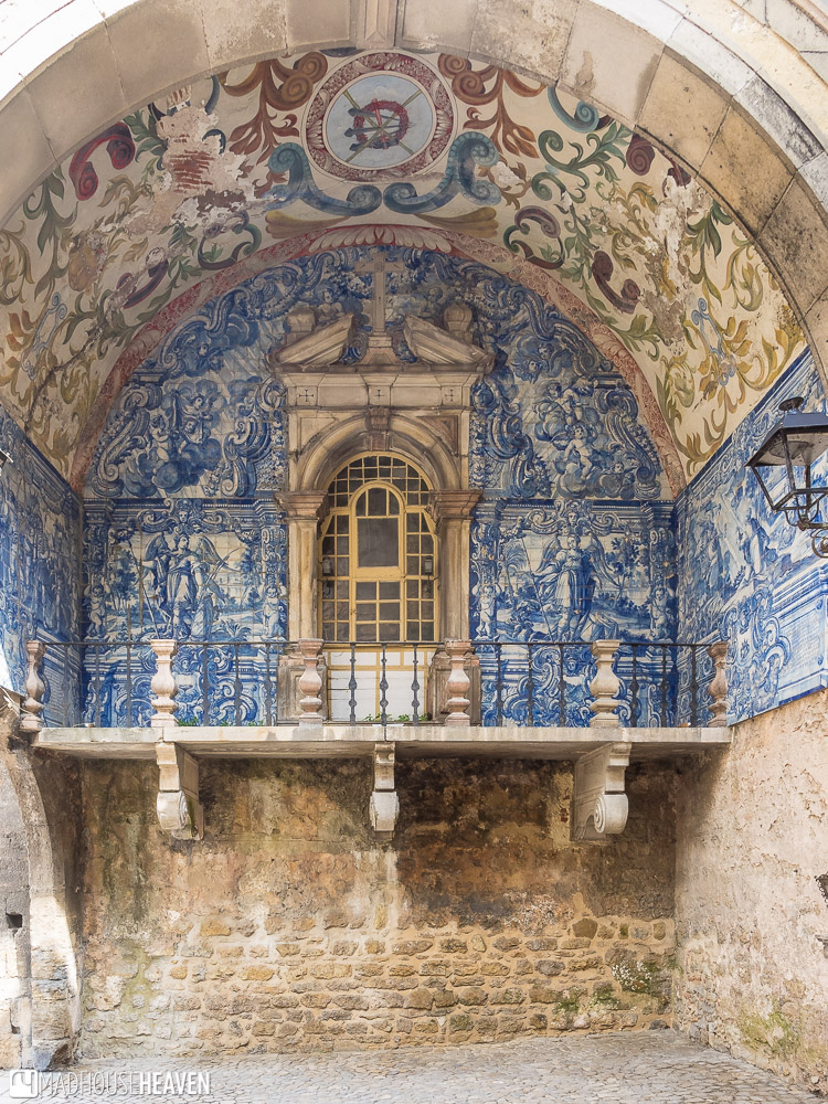 An elaborate door with blue and white Portuguese tiles referred to as Azulejos