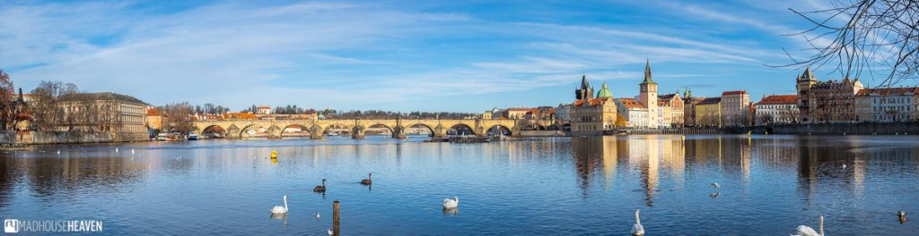 Panorama of the Charles Bridge and the Vltava River in Prague on a sunny winter day